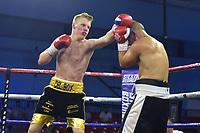 Derek Renfrew (black/gold shorts) defeats Mark Krammerstodter during a Boxing Show at Bracknell Leisure Centre on 8th July 2018