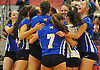 Mattituck No. 5 Kathryn Zaloom, far right, and teammates celebrate after their 3-1 win over Babylon in the Suffolk County varsity girls' volleyball Class C final against Shelter Island at Suffolk Community College Grant Campus on Monday, November 9, 2015.