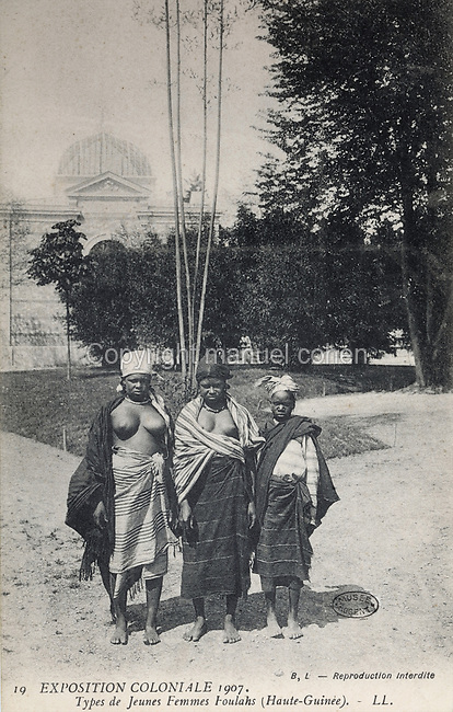 Fula women from Upper Guinea, West Africa at the Colonial Exhibition of 1907, held in the Jardin d'Agronomie Tropicale, or Garden of Tropical Agronomy, in the Bois de Vincennes in the 12th arrondissement of Paris, postcard from the nearby Musee de Nogent sur Marne, France. The garden was first established in 1899 to conduct agronomical experiments on plants of French colonies. In 1907 it was the site of the Colonial Exhibition and many pavilions were built or relocated here. The garden has since become neglected and many structures overgrown, damaged or destroyed, with most of the tropical vegetation disappeared. The site is listed as a historic monument. Picture by Manuel Cohen / Musee de Nogent sur Marne