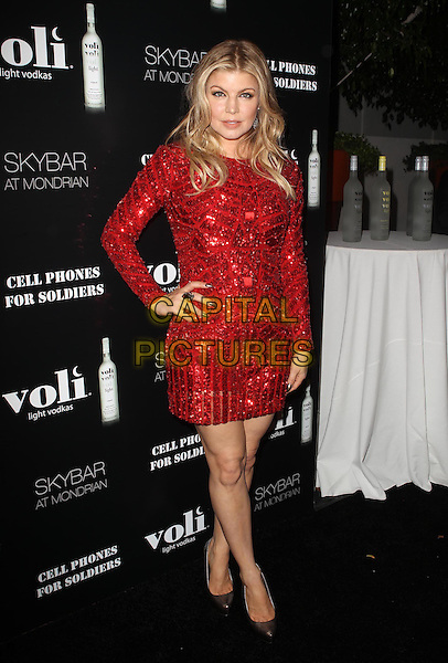 Fergie, Stacy Ferguson, Black Eyed Peas.Voli Lights Vodka Benefit With Fergie Held at SkyBar at the Mondrian. West Hollywood, California, USA, .6th December 2012..full length red dress long sleeve hand on hip sequined sequin .CAP/ADM/KB.©Kevan Brooks/AdMedia/Capital Pictures.