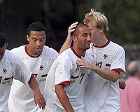 Boston College forward/midfielder Amit Aburmad (7) celebrates his goal with teammates. Boston College defeated Quinnipiac, 5-0, at Newton Soccer Field, September 1, 2011.