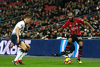 Nathan Redmond of Southampton and Juan Foyth of Tottenham Hotspur during Tottenham Hotspur vs Southampton, Premier League Football at Wembley Stadium on 5th December 2018