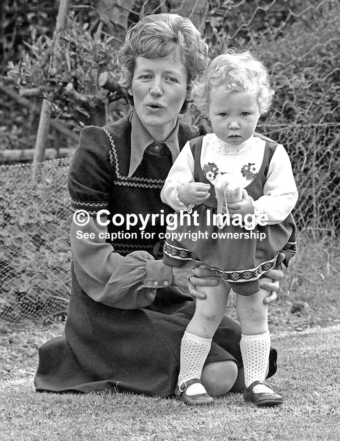 RUC widow, Mrs Maurice Rolston, pictured with her daughter, Cheryl, 18 months after her husband's death on 11th December 1973. He died when his booby-trapped car exploded outside his home in Newcastle, Co Down, N Ireland, as he was about to drive off. It is believed the bomb was planted by members of the Provisional IRA whilst Detective Constable Rolston was dining with his family. 197505230462b<br /> <br /> Copyright Image from Victor Patterson, 54 Dorchester Park, <br /> Belfast, UK, BT9 6RJ<br /> <br /> t1: +44 28 9066 1296 (from Rep of Ireland 048 9066 1296)<br /> t2: +44 28 9002 2446 (from Rep of Ireland 048 9002 2446)<br /> m: +44 7802 353836<br /> <br /> e1: victorpatterson@me.com<br /> e2: victorpatterson@gmail.com<br /> <br /> www.victorpatterson.com<br /> <br /> Please see my Terms and Conditions of Use at www.victorpatterson.com. It is IMPORTANT that you familiarise yourself with them.<br /> <br /> Images used on the Internet must be visibly watermarked i.e. &copy; Victor Patterson within the body of the image and copyright metadata must not be deleted. Images used on the Internet have a size restriction of 4kbs and will be chargeable at current NUJ rates unless agreed otherwise.<br /> <br /> This image is only available for the use of the download recipient i.e. television station, newspaper, magazine, book publisher, etc, and must not be passed on to any third party. It is also downloaded on condition that each and every usage is notified within 7 days to victorpatterson@me.com<br /> <br /> The right of Victor Patterson to be identified as the author is asserted in accordance with The Copyright Designs And Patents Act (1988).