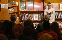 """ANDY SHUPE Northwest Arkansas Times<br /> Geoffrey Brock, assistant professor in the fields of creative writing and translation at the University of Arkansas, reads some of his work during a 2007 reading at Nightbird Books in Fayetteville. Brock read from his collection of poetry, """"Weighing Light,"""" as well as from his translation, """"Skylight Farm,"""" a novel about the Armenian genocide."""