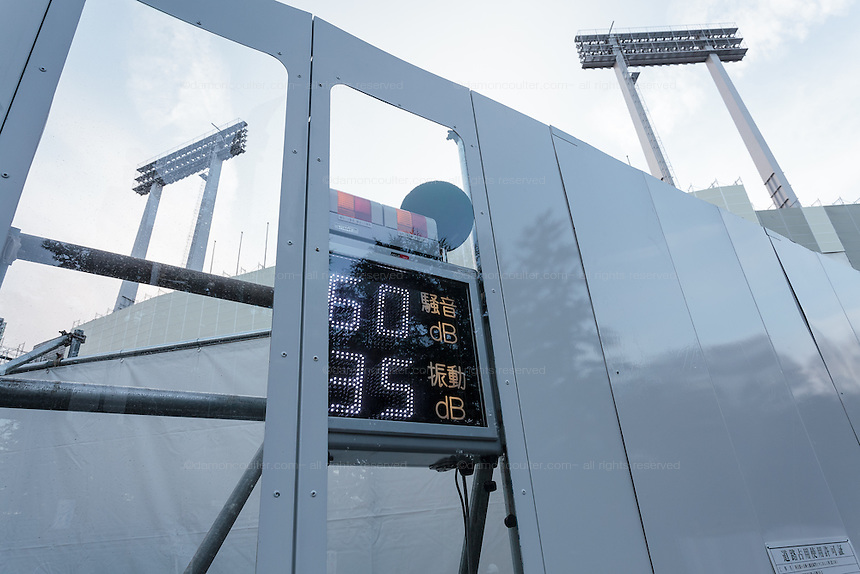A meter measures noise pollution at the demolition of the National Stadium, Shinjuku, Tokyo, Japan. Friday March 6th 2015. Large scale demolition work officially began, March 5th to remove  the old stadium, which was the venue for the 1964 Olympics, after many delays. Construction of the new Olympic stadium for the 2020 games is scheduled to begin in October 2015