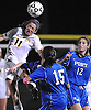 Massapequa No. 11 Hope Breslin makes a header during the Nassau County varsity girls' soccer Class A final against Port Washington at Cold Spring Harbor High School on Tuesday, November 3, 2015.<br /> <br /> James Escher