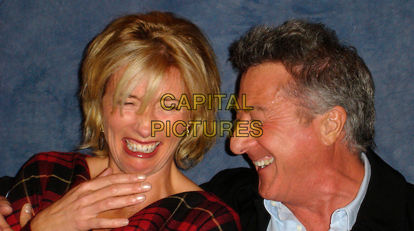 EMMA THOMPSON & DUSTIN HOFFMAN.Photocall for in the Wetherly Room at The Four Seasons Hotel in Beverly Hills, USA. .November 1st, 2006.Ref: AW.headshot portrait laughing profile. oprowww.capitalpictures.com.sales@capitalpictures.com.©Anita Weber/Capital Pictures.