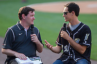 Joey Logano, driver of the #22 Ford Fusion for Team Penske, is interviewed by Charlotte Knights radio color commentator Mike Pacheco (left) prior to the International League game between the Norfolk Tides and the Charlotte Knights at BB&T Ballpark on May 21, 2014 in Charlotte, North Carolina.  (Brian Westerholt/Four Seam Images)