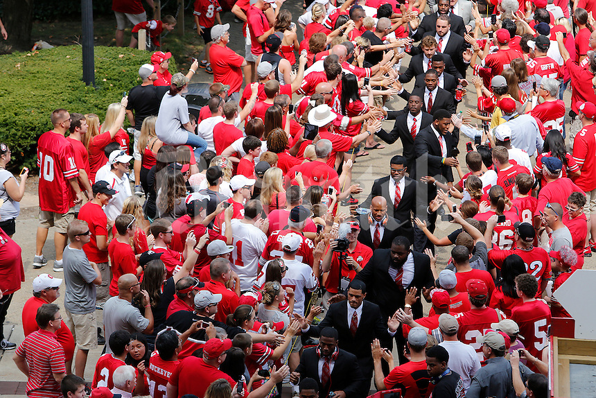 The Ohio State University football team walks from  St. John Arena to the stadium before the start of a football game between the Ohio State Buckeyes and the San Diego State Aztecs on Sept. 7, 2013 at Ohio Stadium. (Columbus Dispatch photo by Fred Squillante)
