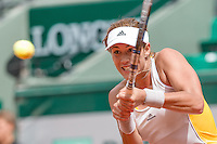 June 1, 2015: Garbine Muguruza of Spain in action in a 4th round match against Flavia Pennetta of Italy on day nine of the 2015 French Open tennis tournament at Roland Garros in Paris, France. Sydney Low/AsteriskImages
