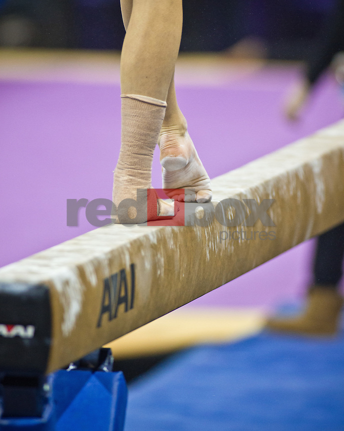 closeup, detail, balance beam, chalk, feet..Washington Huskies gymnastics vs. the UCLA Bruins at Alaska Airlines Arena at Hec Edmundson Pavilion in Seattle on Friday, January 27, 2012. (Photo by Dan DeLong/Red Box Pictures)