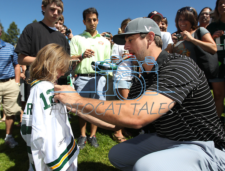 Aaron Rogers signs autographs for fans at the 22nd American Century Celebrity Golf Championship at Edgewood Tahoe Golf Course in Stateline, Nev., on Thursday, July 14, 2011.<br /> Photo by Cathleen Allison