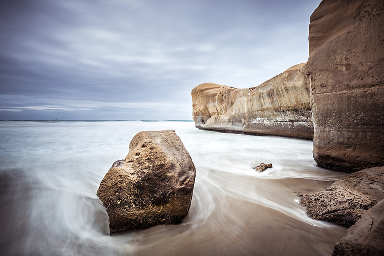 Swirling waves and sandstone cliffs, Tunnel Beach, Dunedin New Zealand - stock photo, canvas prints, fine art print
