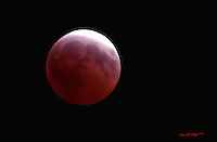 The moon turns red due to a lunar eclipse in the skies above Alaska.
