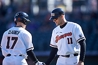 Oregon State Beavers Troy Claunch (17) is congratulated by manager Mitch Canham (11) as he rounds the bases after hitting a home run during an NCAA game against the New Mexico Lobos at Surprise Stadium on February 14, 2020 in Surprise, Arizona. (Zachary Lucy / Four Seam Images)