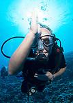 Diver giving the sign of shrk sight,Molokini Maui Hawaii.