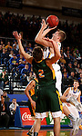 BROOKINGS, SD - DECEMBER 28:  Reed Tellinghuisen #23 from South Dakota State takes the ball to the basket against Paul Miller #2 from North Dakota State during their game Wednesday night at Frost Arena in Brookings. (Dave Eggen/Inertia)