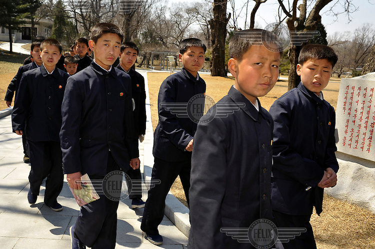 A group of students visiting the birthplace of Kim Il-sung.