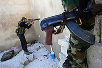 Photographer: Rick Findler/Borderline News..17.01.13 Soldiers belonging to the Free Syrian Army return covering fire to support their comrades after a mission to have a closer look at Minnagh Military Airport. They are hoping to plan an offensive attack to take the airport from Assad control outside of Aleppo, Northern Syria.