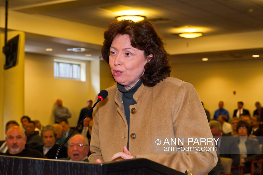 Patricia Maher, resident of East Meadow, speaking against closing 4 Police Precincts at Nassau County Legislature Public Meeting, which later voted to close 4 of 8 police precincts,  on Monday, March 5, 2012, at Mineola, New York, USA.