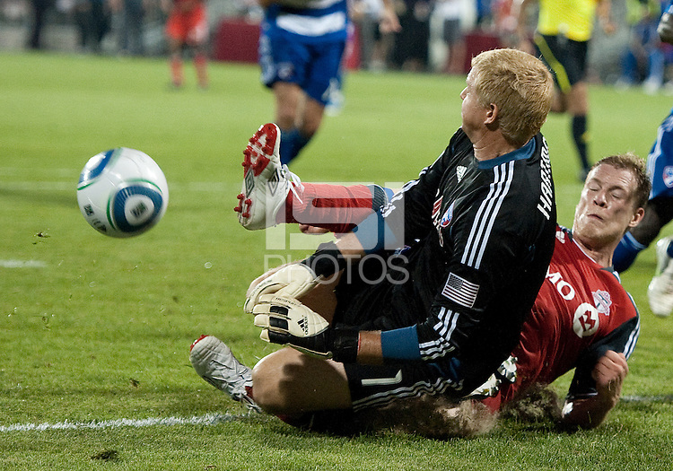 FC Dallas goalkeeper Kevin Hartman #1 and Toronto FC defender Ty Harden #20 in action during an MLS game between the FC Dallas and the Toronto FC at BMO Field in Toronto on July 20, 2011..FC Dallas won 1-0.