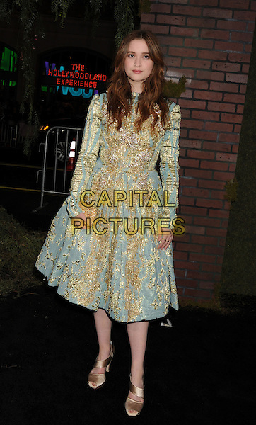 "Alice Englert.arriving at the Los Angeles premiere of ""Beautiful Creatures"" at TCL Chinese Theatre in Hollywood, California, USA, .February 6th, 2013..full length gold green blue long sleeve dress clutch bag sandals .CAP/ROT/TM.©Tony Michaels/Roth Stock/Capital Pictures"