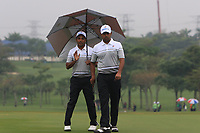 SSP Chawrasia (Asia) and Anirban Lahiri (Asia) on the 1st green during the Saturday Foursomes of the Eurasia Cup at Glenmarie Golf and Country Club on the 13th January 2018.<br /> Picture:  Thos Caffrey / www.golffile.ie