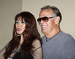 """One Life To Live BarBara Luna """" Maria Roberts"""" and also on Sunset Beach poses with actor Peter Fonda at Chiller Theatre - Toy, Model and Film Expo was held over the weekend - October 27, 2013 at the Sheraton Hotel, Parsippany, New Jersey - (Photo by Sue Coflin/Max Photos)"""