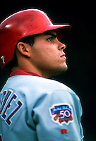 Ivan Rodriguez of the Texas Rangers during a game at Dodger Stadium in Los Angeles, California during the 1997 season.(Larry Goren/Four Seam Images)