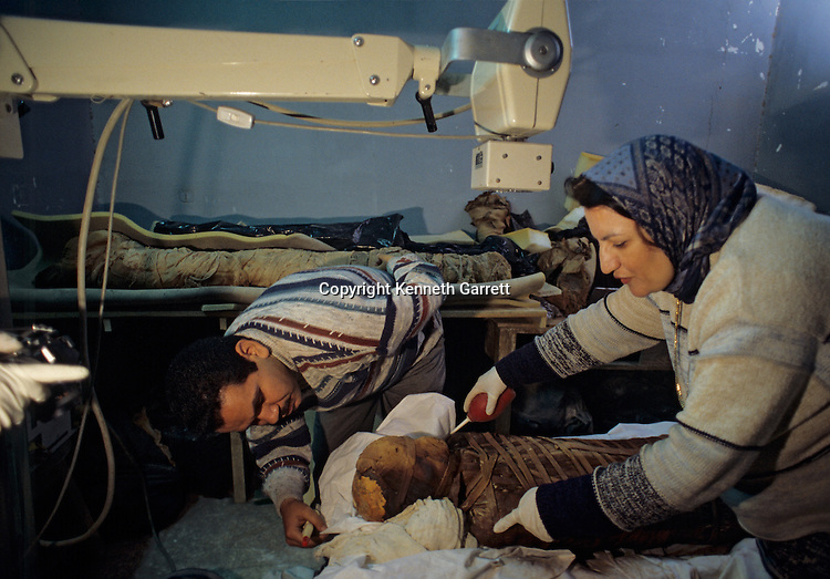 Anthropologist prepare mummy of MR. X for tests; Egypt; Archaeology; Bahariya Oasis; Greco-Roman;Golden Mummies; Valley of the Golden Mummies; Book originals; mummies
