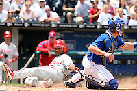 Philadelphia Phillies second baseman Abraham Nunez slides past catcher John Buck to score on a Jimmy Rollins double to left field during the fourth inning at Kauffman Stadium in Kansas City, Missouri on June 10, 2007.  The Royals won 17-5.