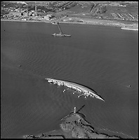 BNPS.co.uk (01202 558833)<br /> Pic: Aerofilms/HistoricEngland/BNPS<br /> <br /> Fiddlers Reach, River Thames, 8 November 1964.<br /> <br /> Stunning historic aerial photos of seaside towns, naval bases, ports and shipyards which tell the story of Britain's once-great maritime tradition feature in a new book.<br /> <br /> The fascinating archive of black and white images includes views from a bygone age such as Brighton's famous West Pier, Grimsby's burgeoning fishing fleet, and London's dock yards.<br /> <br /> Iconic ships were also captured from the skies including the Cutty Sark in its final seaworthy years on the Thames, HMY Britannia in 1959, the RMS Queen Mary in 1946 and the SS Queen Elizabeth in 1969 about to make her maiden voyage.<br /> <br /> England's Maritime Heritage from the Air, by Peter Waller, is published by English Heritage and costs &pound;35.