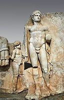 Close up of a Roman Sebasteion relief  sculpture of Emperor Nero with captive, Aphrodisias Museum, Aphrodisias, Turkey. <br /> <br /> Naked warrior emperor Nero holds the orb of world rule in one hand and crowns the military trophy with the other. Between the trophy and the emperor stands a bound captive boy. He wears long barbarian trousers and looks up at Nero.