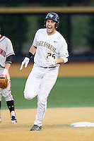 Matt Conway (25) of the Wake Forest Demon Deacons reacts as he rounds second base following his second home run of the game against the Maryland Terrapins at Wake Forest Baseball Park on April 4, 2014 in Winston-Salem, North Carolina.  The Demon Deacons defeated the Terrapins 6-4.  (Brian Westerholt/Four Seam Images)