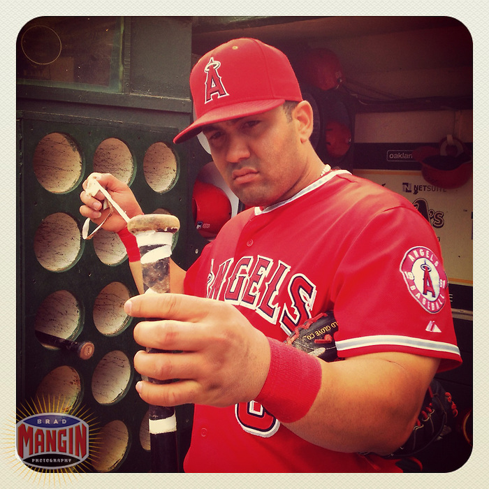 OAKLAND, CA - SEPTEMBER 5:  Instagram of Kendrys Morales of the Los Angeles Angels getting ready in the dugout before the game against the Oakland Athletics at O.co Coliseum on September 5, 2012 in Oakland, California. Photo by Brad Mangin