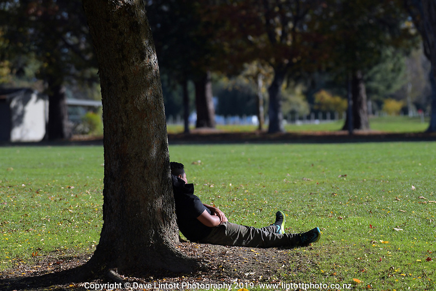 A fan takes a break under the trees during the Transit Coachlines 1st XV Festival rugby union match between St Patrick's College Silverstream College and Hastings Boys' High School at Rathkeale College in Masterton, New Zealand on Saturday, 4 May 2019. Photo: Dave Lintott / lintottphoto.co.nz