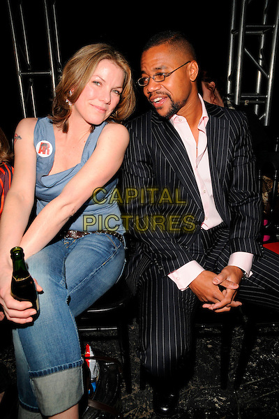 SARAH STOCKBRIDGE & CUBA GOODING JR..The Vivienne Westwood Red Label LFW catwalk show, The Old Sorting Post Office, New Oxford Street, London, England..February 14th, 2008.fashion week full length sitting black 3/4 pinstripe suit blue tank top jeans denim drink beverage champagne bottle .CAP/CAN.©Can Nguyen/Capital Pictures.