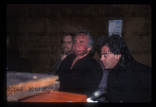"""JOHNNY CASH - Tom Petty, Johnny Cash and Marty Stuart during the recording sessions for Johnny Cash's """"Unchained"""" CD Produced by Rick Rubin.   Photographed at Sound City Studios in Van Nuys, CA USA - January 26, 1996.  Photo © Kevin Estrada / Iconicpix"""