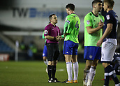 9th February 2018, The Den, London, England; EFL Championship football, Millwall versus Cardiff City; Sean Morrison of Cardiff City asks Referee Keith Stroud after the final whistle for an explanation to why he ruled Sol Bamba's goal out