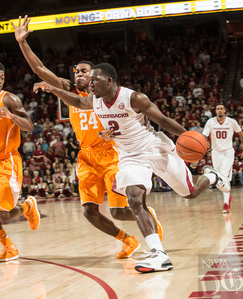 NWA Democrat-Gazette/ANTHONY REYES &bull; @NWATONYR<br /> Alandise Harris, Arkansas senior, drives to the basket as Willie Carmichael, Tennessee freshman defends in the second half Tuesday, Jan. 27, 2015 in Bud Walton Arena in Fayetteville. The Razorbacks won 69-64.