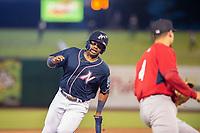 Northwest Arkansas Naturals outfielder Khalil Lee (24) runs for third on May 18, 2019, at Arvest Ballpark in Springdale, Arkansas. (Jason Ivester/Four Seam Images)