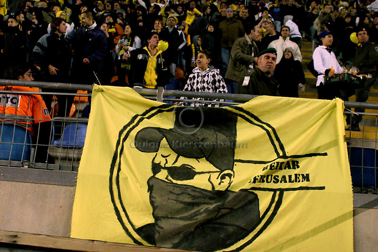 """A Betar Jerusalem Hebrew sign is seen during the match for the league against Hapoel Tel Aviv in the Jerusalem stadium """"Tedy"""". Hapel Tel Aviv is considered by Betar fans  the worst enemy in the league which represents the Ashkenazy (European born) lefty club.  Beitar won the match 2 -1. Beitar Jerusalem FC was founded in the 1930's by the right-wing Revisionist Zionist movement, which later formed the Israeli Likud political party, during the British Mandate rule over Palestine. The chanting of the club is racist and mainly against Arabs. The team is the only one in the Israeli league to have never had an Arab player. Beitar is seen as the right wing and Mizrahi (Jews who came from Asia and Africa) club. Photo by Quique Kierszenbaum"""