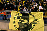 "A Betar Jerusalem Hebrew sign is seen during the match for the league against Hapoel Tel Aviv in the Jerusalem stadium ""Tedy"". Hapel Tel Aviv is considered by Betar fans  the worst enemy in the league which represents the Ashkenazy (European born) lefty club.  Beitar won the match 2 -1. Beitar Jerusalem FC was founded in the 1930's by the right-wing Revisionist Zionist movement, which later formed the Israeli Likud political party, during the British Mandate rule over Palestine. The chanting of the club is racist and mainly against Arabs. The team is the only one in the Israeli league to have never had an Arab player. Beitar is seen as the right wing and Mizrahi (Jews who came from Asia and Africa) club. Photo by Quique Kierszenbaum"