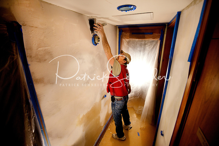 Lowe's assocites from the Seattle Washington area work to polish up the inside quarters of the USO of the Puget Sound Area located inside of the Seattle's Sea-Tac International Airport.