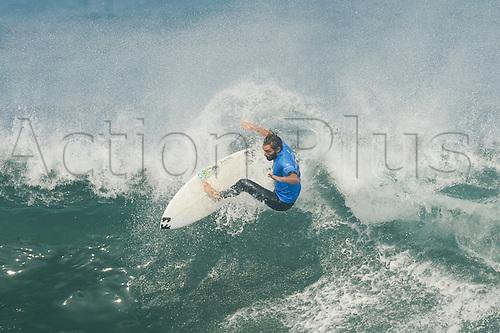 April 19th Bells Beach, Melbourne, Victoria, Australia; Rip Curl Pro Bells Beach Surfing; Frederico Morais (PRT) surfing a wave during his quarter final heat against Caio Ibelli (BRA); Caio Ibelli (BRA) went on to win the heat