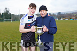 PS IS Kenmare captain Donal O'Sullivan celebrates with manager Mickey Ned O'Sullivan  Michelstown CBS after the Munster Colleges B final in Ballyvourney on Saturday
