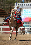 Shane Harrington races in the 54th International Camel Races in Virginia City, Nev., on Friday, Sept. 6, 2013.  <br /> Photo by Cathleen Allison