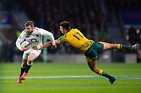 Elliot Daly of England is tackled by Jack Maddocks of Australia. Quilter International match between England and Australia on November 24, 2018 at Twickenham Stadium in London, England. Photo by: Patrick Khachfe / Onside Images