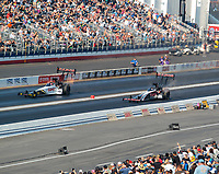 Nov 11, 2018; Pomona, CA, USA; NHRA top fuel driver Steve Torrence (left) defeats father Billy Torrence during the Auto Club Finals at Auto Club Raceway. Mandatory Credit: Mark J. Rebilas-USA TODAY Sports