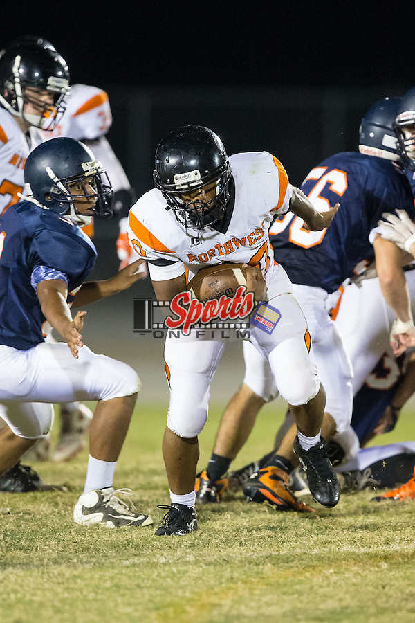 Janai Spratt (40) of the Northwest Cabarrus Trojans runs with the football during second half action against the Carson Cougars at Jesse Carson High School on October 24, 2014, in China Grove, North Carolina.  The Cougars defeated the Trojans 35-6.  (Brian Westerholt/Sports On Film)
